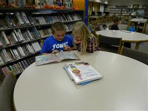 Friends Reading during Library time.